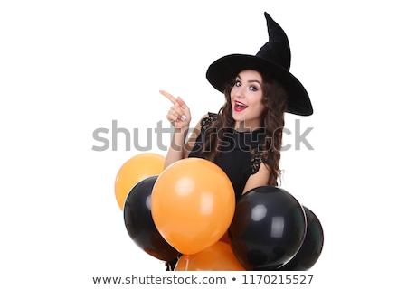Atraente mulher jovem bruxa halloween traje laranja Foto stock © deandrobot