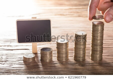 Person Placing Coin Over The Stack With Blank Chalk Board Stock photo © AndreyPopov