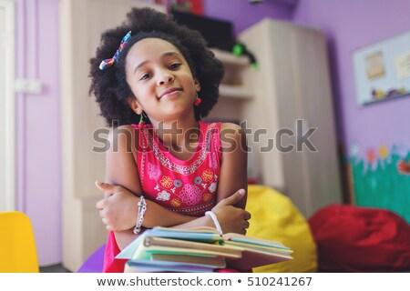 four kids reading books stock photo © bluering