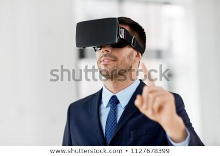empresario · futurista · teléfono · móvil · blanco · negocios · vidrio - foto stock © stevanovicigor