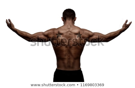 A man with tattooes on his arms. Silhouette of muscular body. caucasian brutal hipster guy with mode Stock photo © iordani