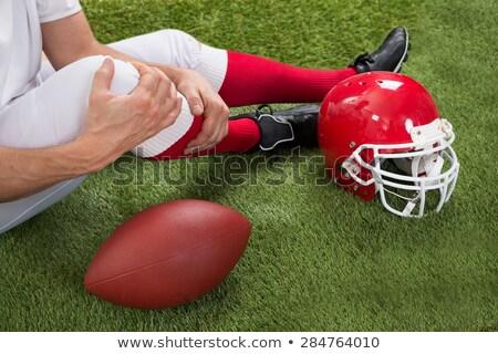Rugby jogador ferido joelho sessão campo Foto stock © wavebreak_media