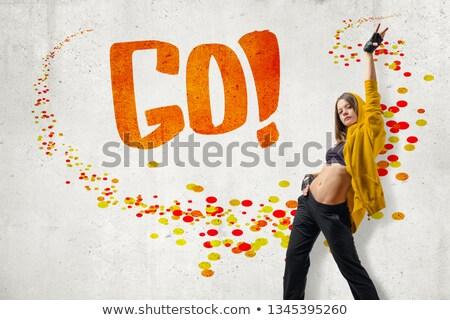 Slim go-go dancer performing on white background Stock photo © julenochek