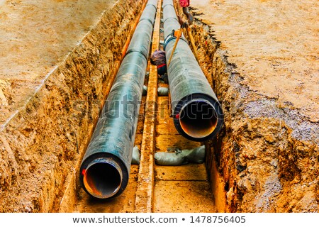 Man in hard hat inspecting steel support Stock photo © IS2