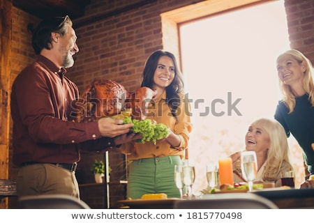 Young Woman Carrying Grilled Chicken Stock photo © IS2