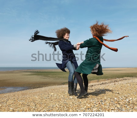 two friends spinning each other around stock photo © is2
