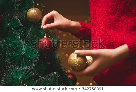 Woman decorating white and gold Christmas tree with ornaments Stock photo © Kzenon