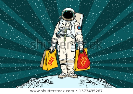 Lone retro astronaut with a sale shopping bags Stock photo © studiostoks