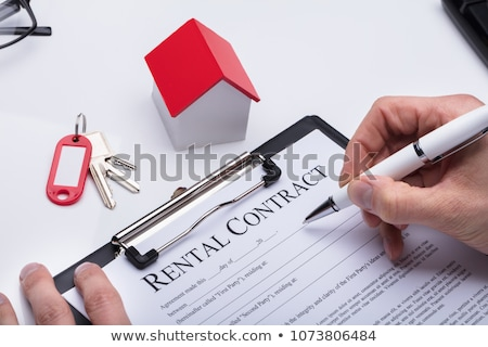 A Rental agreement with a pen on a desk Stock photo © Zerbor