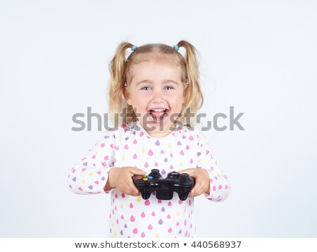 Portrait of an upset little girl playing games Stock photo © deandrobot