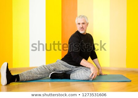 Older man doing sit-ups indoors Stock photo © IS2