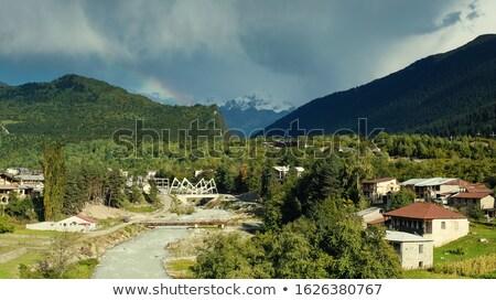 autumn landscape with a mountain river in the town of mestia ge stock photo © kotenko