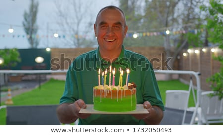 Senior Adult man blowing out candles Stock photo © IS2