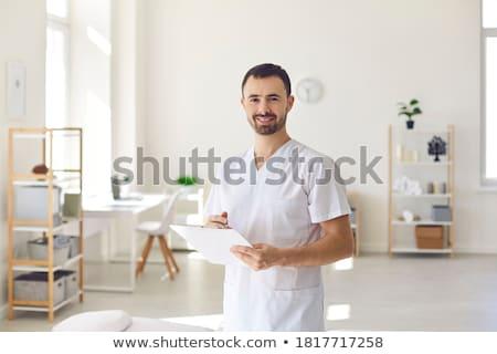 Chiropractor erkekler ayarlamak bilgisayar gülümseme Stok fotoğraf © toyotoyo
