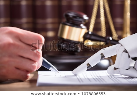 Close-up Of A Robot Filling Document Stock photo © AndreyPopov