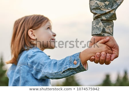 young soldier in military uniform outdoors Stock photo © dolgachov