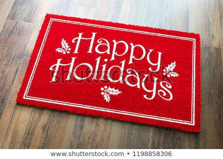 merry christmas red welcome mat on wood floor background stock photo © feverpitch