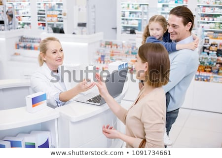apothecary and woman with prescription at pharmacy Stock photo © dolgachov
