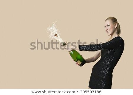 Woman uncorking Champagne Stock photo © rogistok