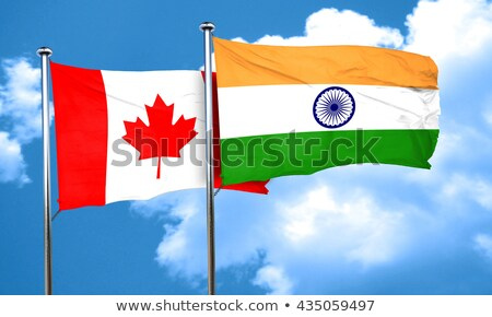 two waving flags of canada and india stock photo © mikhailmishchenko