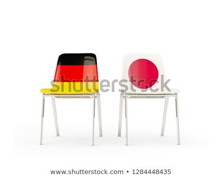 Deux chaises drapeaux Allemagne Japon isolé Photo stock © MikhailMishchenko
