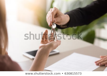 agent getting keys to customer new house hand of real estate ag stock photo © snowing