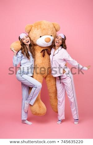 Kettő derűs lányok visel pizsama áll Stock fotó © deandrobot