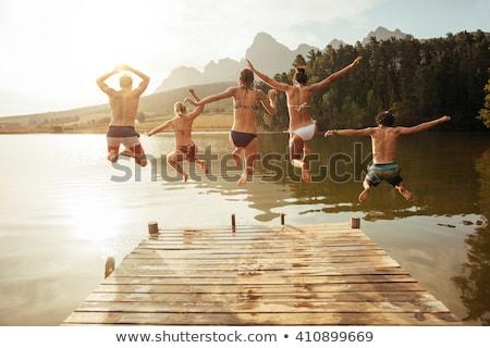 Młoda kobieta bikini molo jezioro atrakcyjny kobieta Zdjęcia stock © boggy