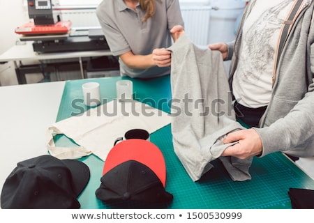 Team in advertising agency discussing which items to use in promotion Foto stock © Kzenon