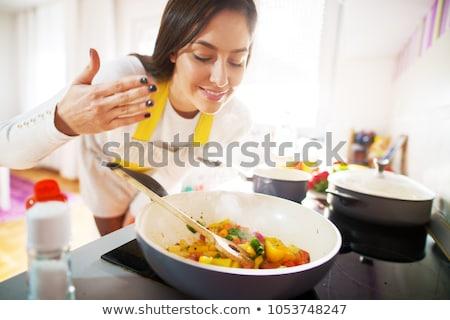 woman cook cleans potatoes stock photo © oleksandro