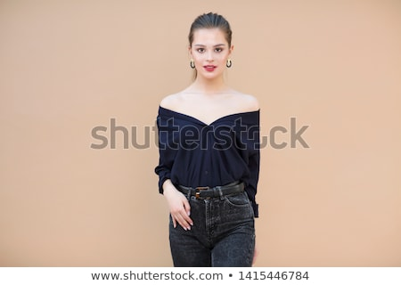 Fashion model wearing navy blue blouse on beige background Stock photo © dashapetrenko