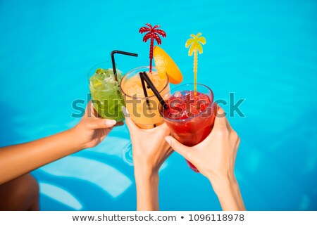 Red And Green Glasses Of Juice On The Beach Stock photo © AndreyPopov
