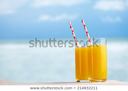 Two Glasses Of Cocktails On The Sandy Beach Stock photo © AndreyPopov