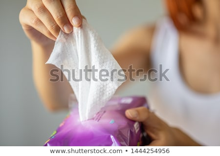 Wet wipes: woman take one wipe from package for cleaning Stock photo © adamr