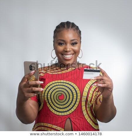 zwarte · vrouw · creditcard · laptop · glimlachend · afro-amerikaanse · vrouw - stockfoto © pressmaster