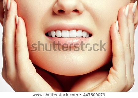 Part of the face close-up, toothy smile, concept after bleaching. Beauty care. Teeth whitening Stock photo © serdechny