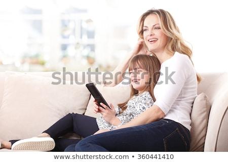 женщину мало дочь пультом диван Сток-фото © dashapetrenko