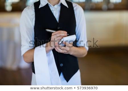 Cameriera piedi tovagliolo ristorante hotel Foto d'archivio © wavebreak_media