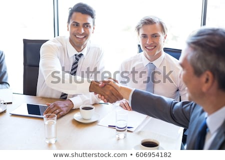 indian businessman with tablet pc on office chair Stock photo © dolgachov