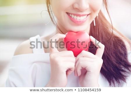gülen · genç · kız · el · ele · tutuşarak · kalp · sevgililer · günü - stok fotoğraf © dolgachov