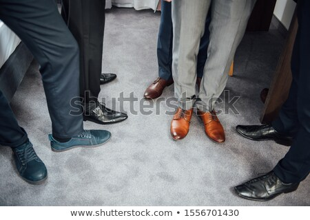 groom and groomsmen men in blue suits standing in group with closeup of shoes and feet stock photo © ruslanshramko