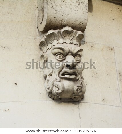 Sculpted stone mask on Pont Neuf in Paris Stock photo © sarahdoow
