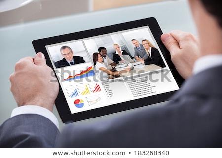 Işadamı video tablet iş arkadaşı melez Stok fotoğraf © AndreyPopov