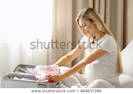pregnant woman with bag for maternity hospital Stock photo © dolgachov