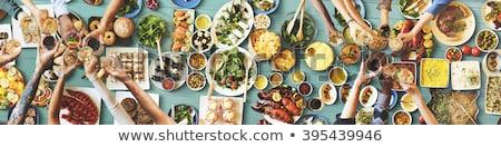 Cheerful people enjoying drink and food in Italian restaurant Stock photo © Kzenon