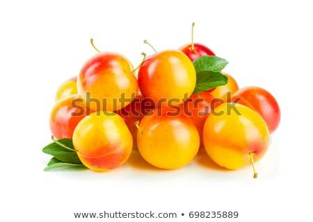 Halom citromsárga szilva vásár piac étel Stock fotó © elxeneize