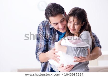 Jóvenes padres recién nacido cuna cuna familia Foto stock © Elnur