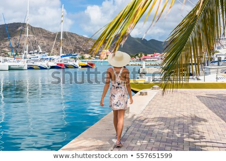 Woman tourist walking in shopping streets of Philipsburg, St Maarten, popular port of call for cruis Stock photo © Maridav