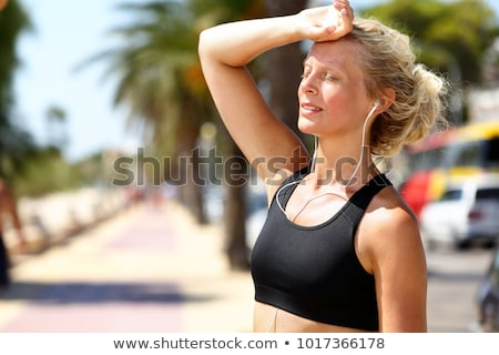 Sport fitness runner woman tired breathing during difficult workout. Heat exhaustion dehydrated jogg Stock photo © Maridav