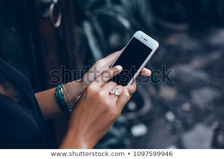 beautiful black woman at home using facebook stock photo © darrinhenry